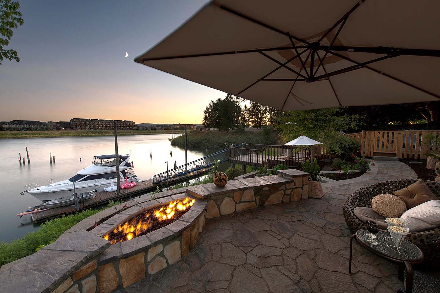 Custom firepit with seat walls on Columbia River
