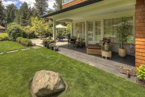 Side Patio, Boulder Accent in Lawn