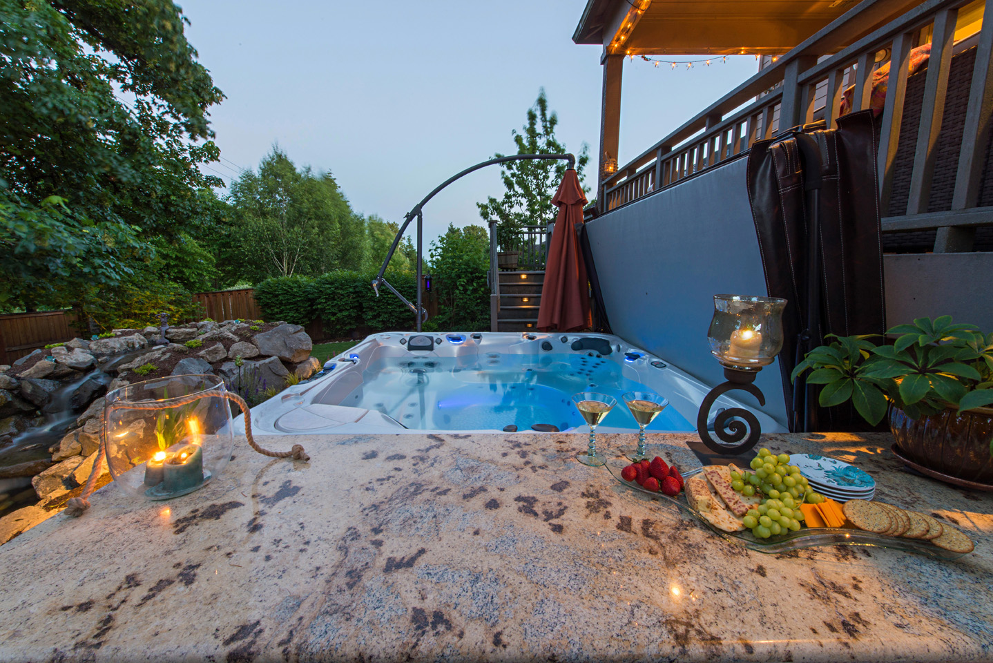 Bar wrapped Spa. Some want to mingle, some want to Soak. . .