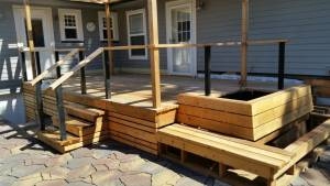 Deck and Custom Wood staircase - with planter near stair rail - unique custom wood design
