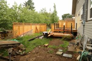 Fence & Deck taking shape - by creating an upper & lower deck, the kids have a play deck near their parents and their playhouse